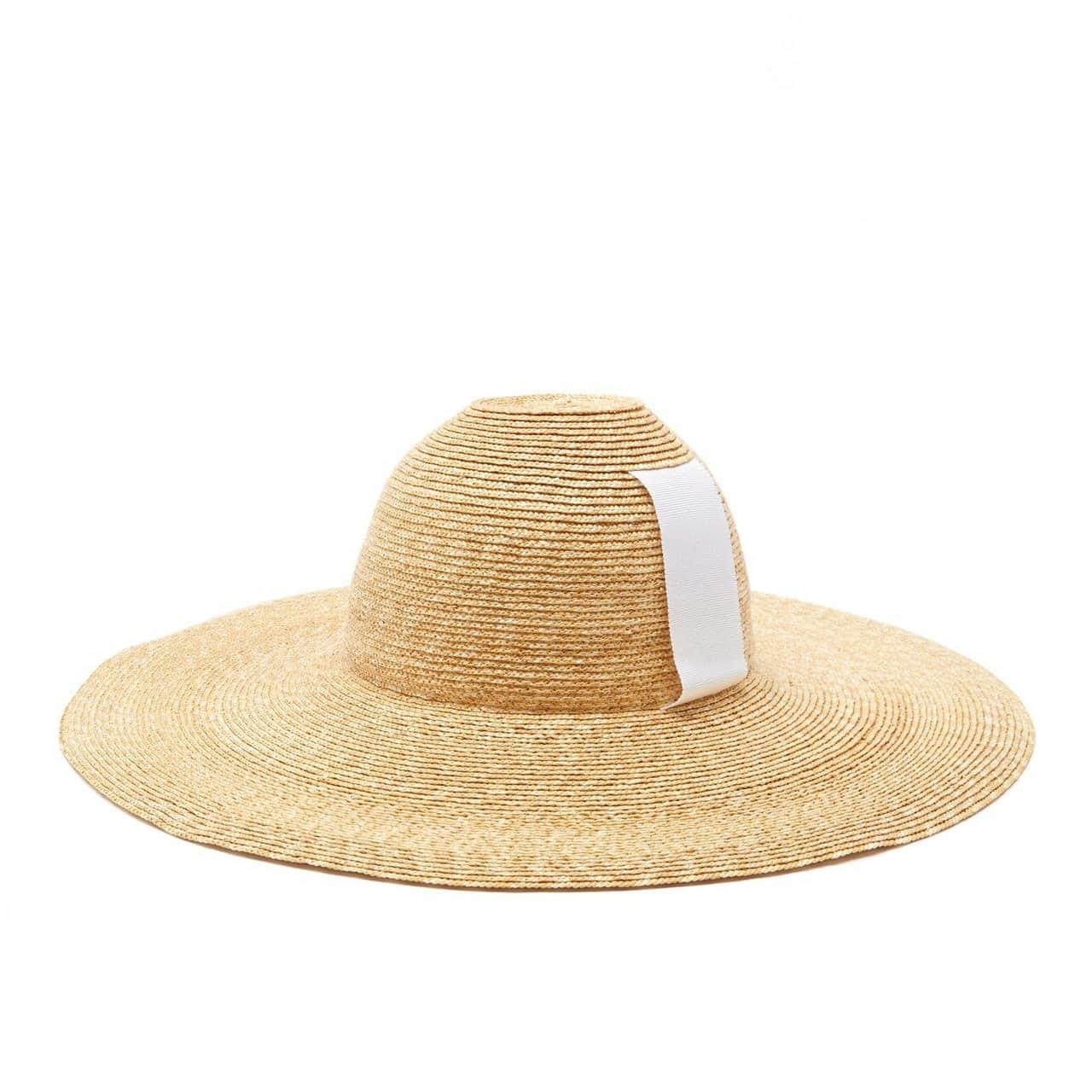 La imagen puede contener: ropa, indumentaria, sombrero para el sol, sombrero, gorra y gorra de béisbol